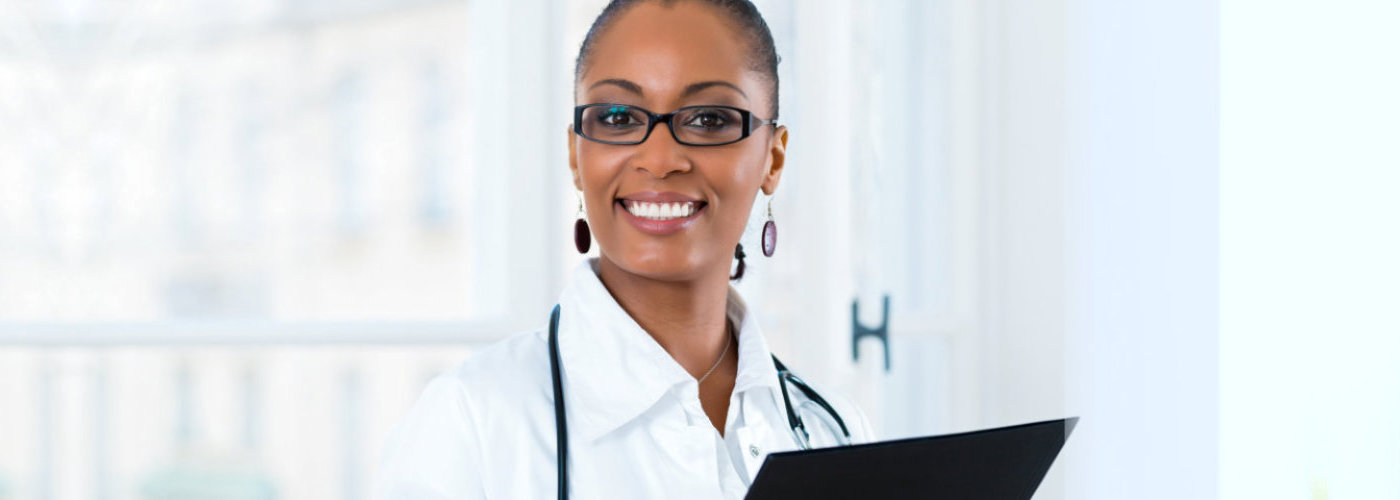 female doctor standing at a window in clinic