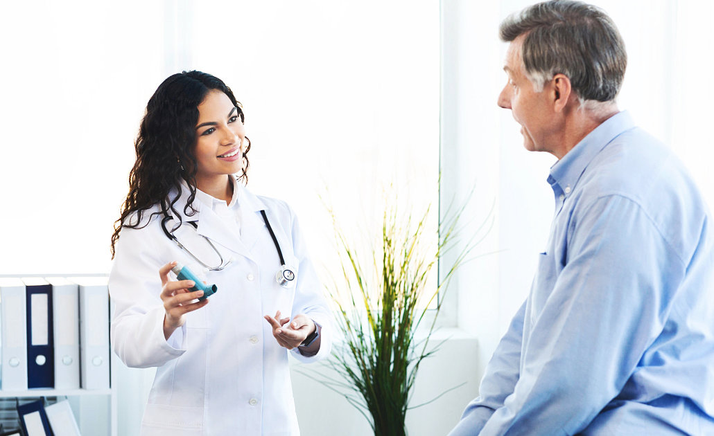 female doctor talking with the senior man
