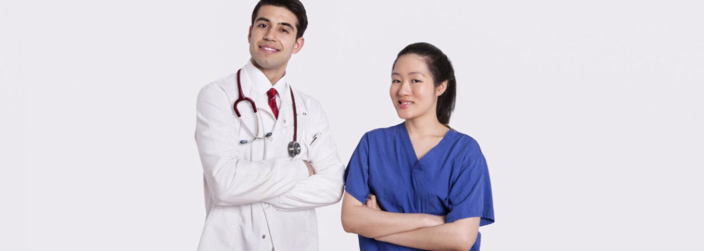 male doctor with her assistant smiling